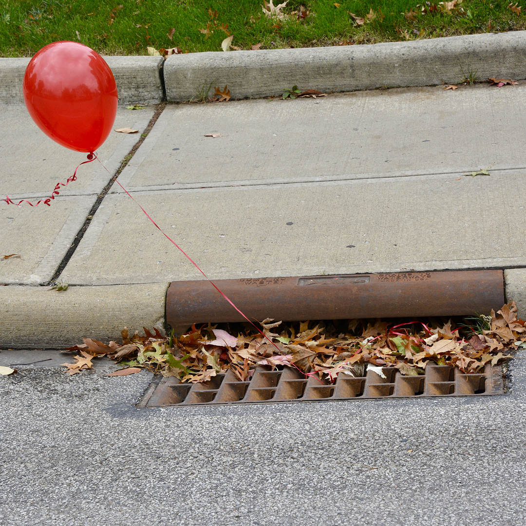 IT red balloons tied to sewer grates spotted on Franklinhellip