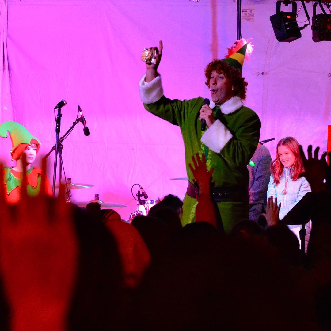 Buddy the Elf works the crowd at Light Up Lakewood